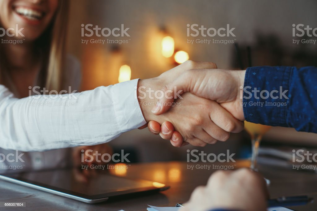 Businessman and businesswoman handshake stock photo