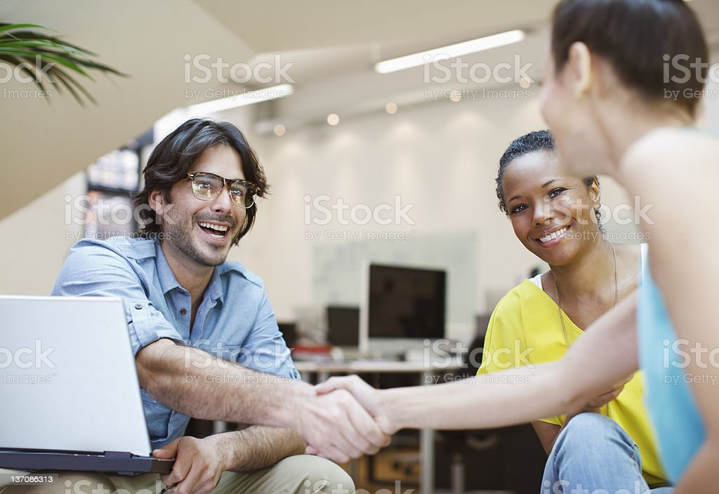 Businessman and businesswoman handshaking in meeting royalty-free stock photo