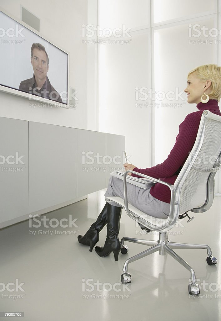 Businessman and businesswoman having a video conference 免版稅 stock photo