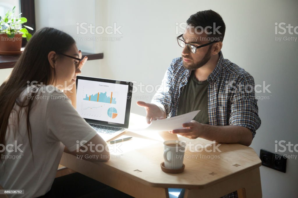 Businessman and businesswoman having argument and work dispute in office stock photo