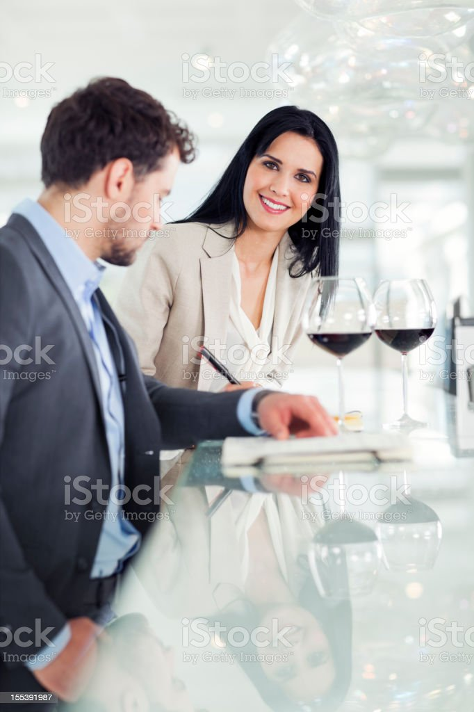 Businessman and businesswoman having drink in bar, restaurant royalty-free stock photo