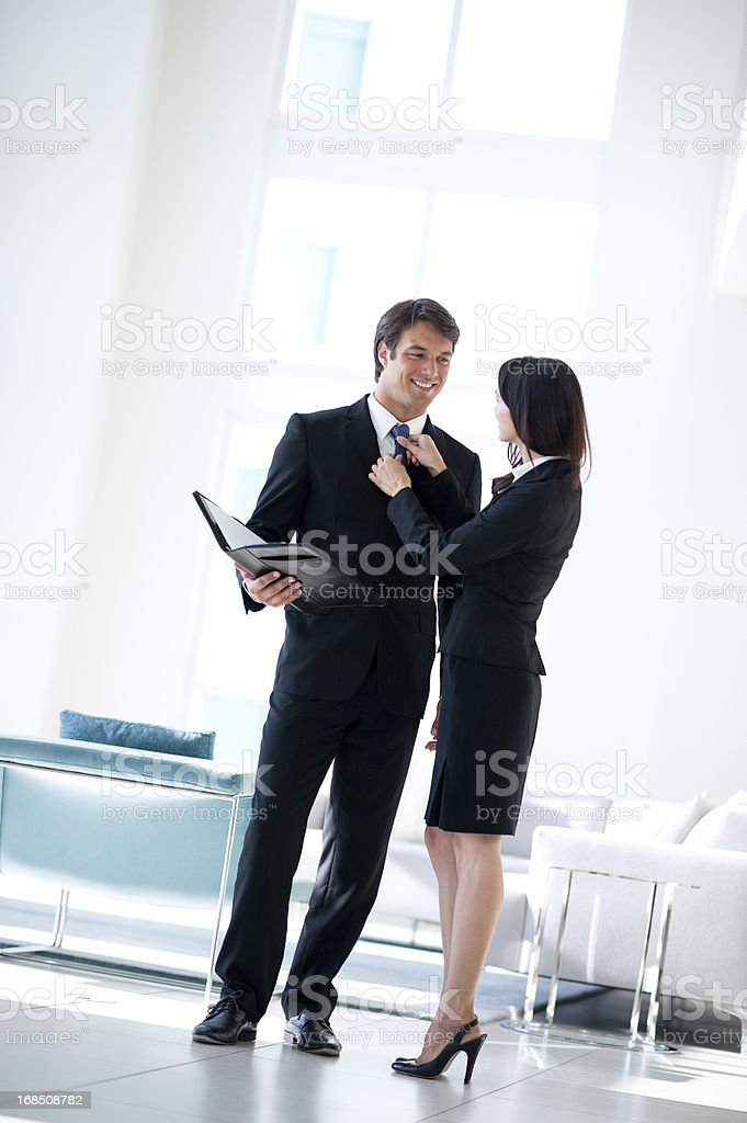 Businessman and Businesswoman in Lobby royalty-free stock photo