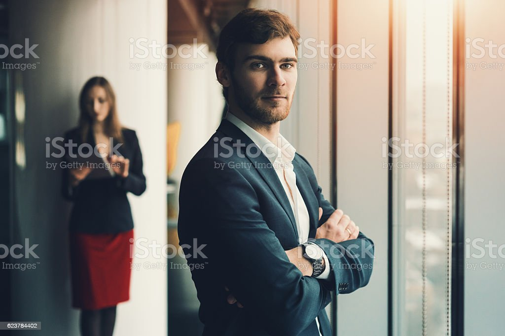 Businessman and businesswoman in office interior – Foto