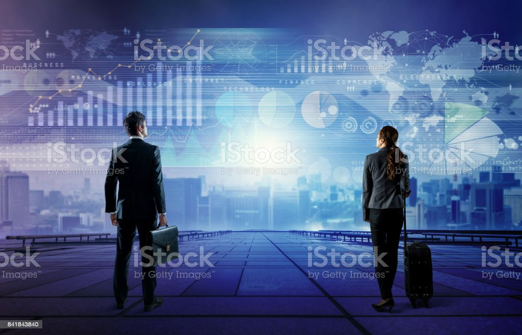 businessman and businesswoman looking at business information. abstract mixed media. stock photo