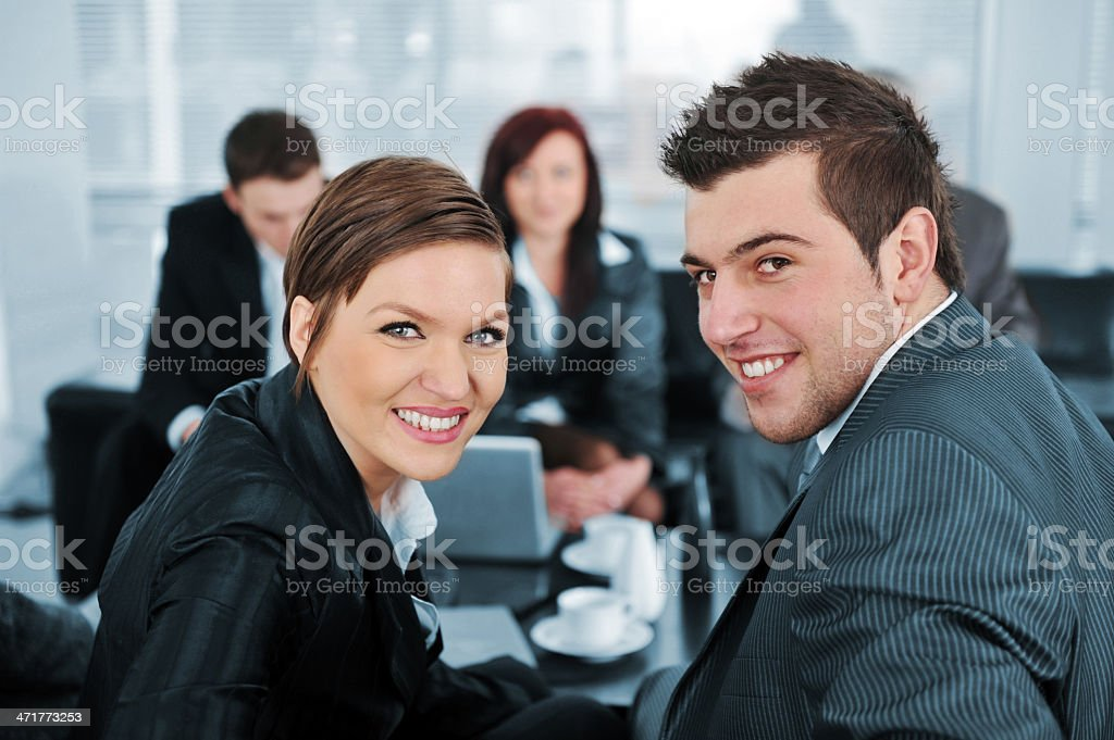 Businessman and businesswoman looking at camera royalty-free stock photo