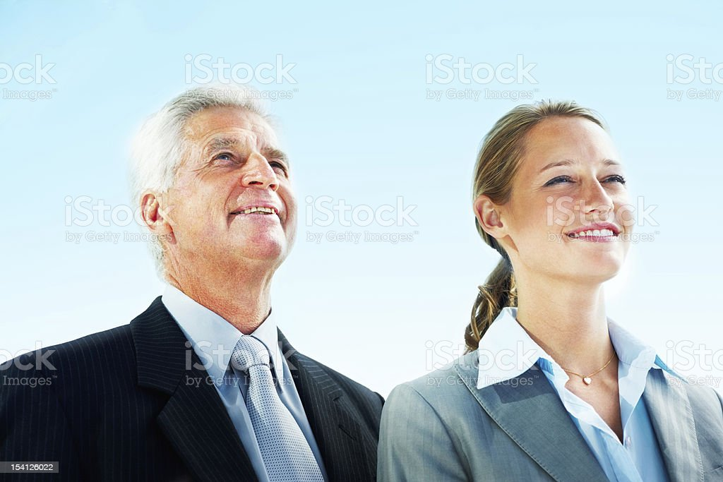 Businessman and businesswoman looking away royalty-free stock photo