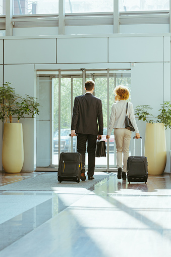 Businessman And Businesswoman On Business Travel Stock Photo - Download Image Now