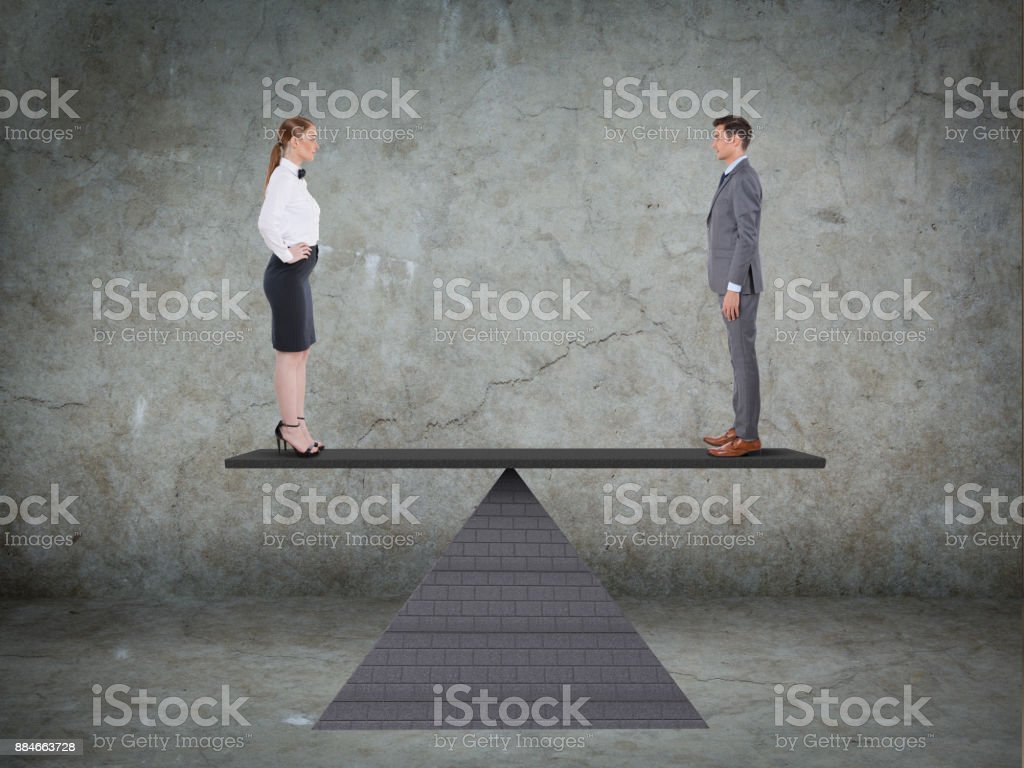 Businessman and businesswoman on seesaw stock photo