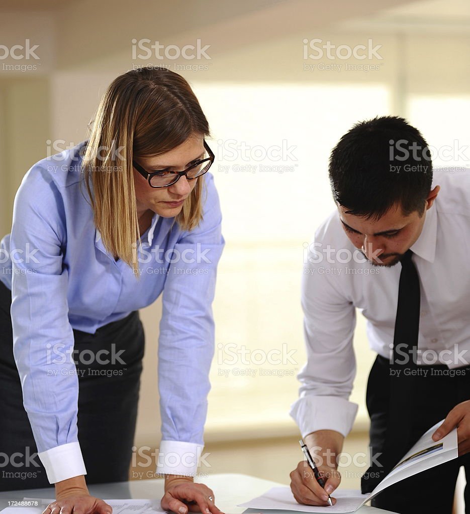 Businessman and businesswoman preparing collective meeting royalty-free stock photo