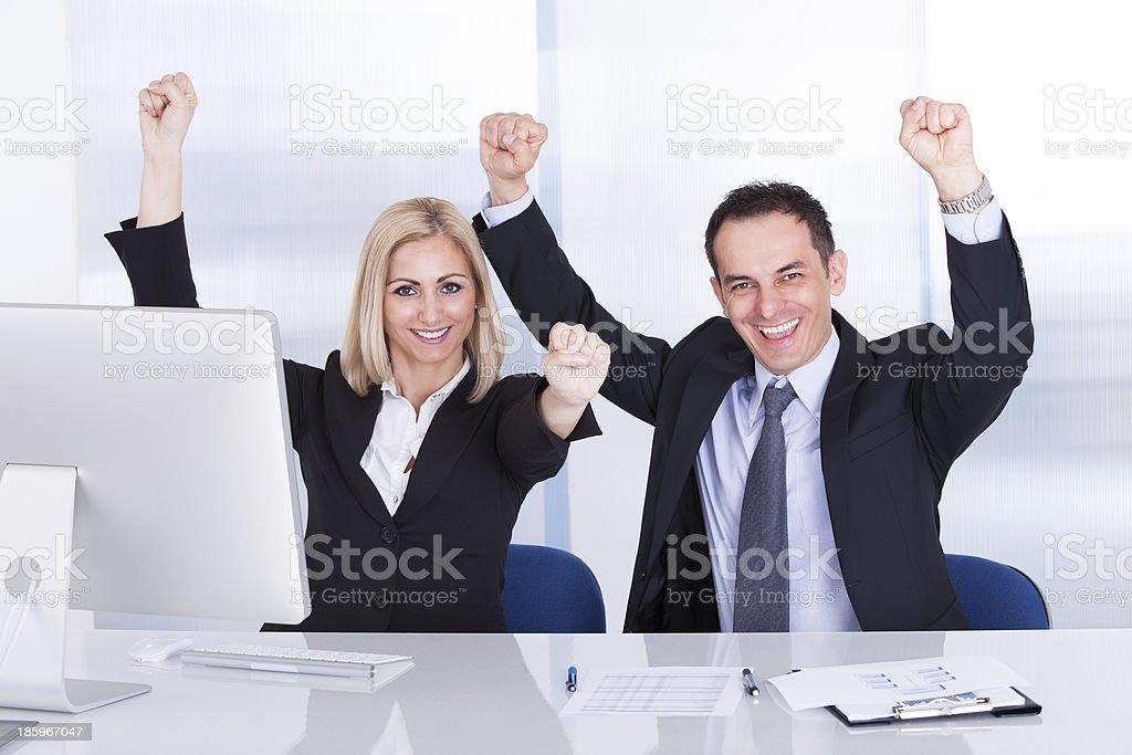 Businessman And Businesswoman Raising Hand royalty-free stock photo