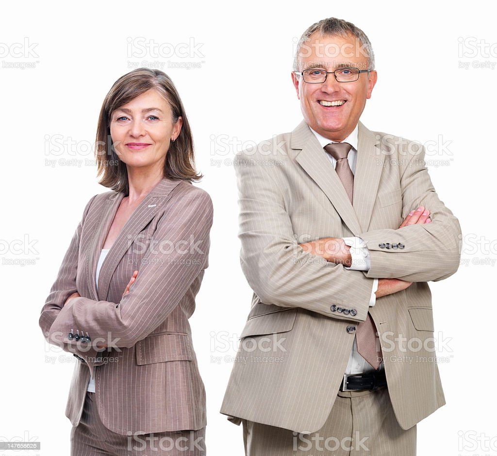 Businessman and businesswoman smiling against white background stock photo