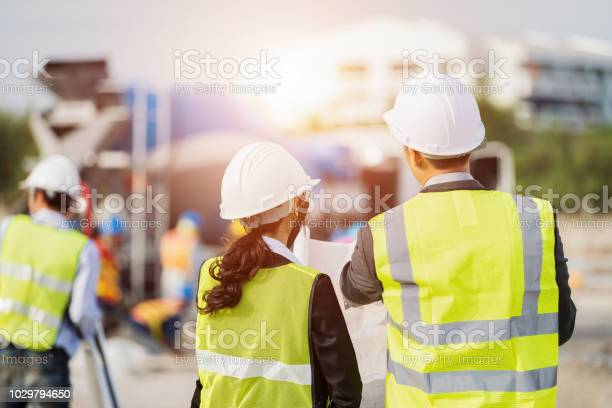 Businessman and businesswoman using see plan paper at construction picture id1029794650?b=1&k=6&m=1029794650&s=612x612&h=ix 43vos9tnmddstdcixftawouaklzoftzgjyeht9y8=