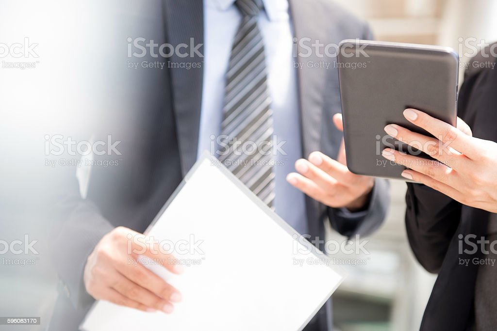 Businessman and businesswoman using  tablet computer royalty-free stock photo