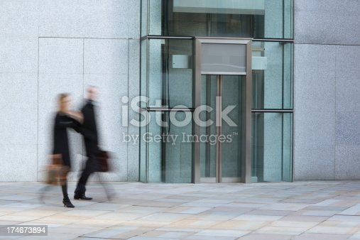 istock Businessman and businesswoman walking in a London's financial district 174673894