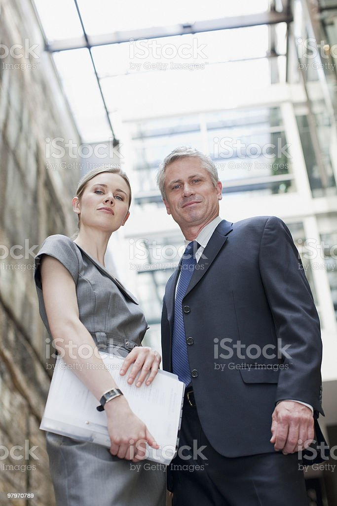Businessman and businesswoman with paperwork royalty-free stock photo