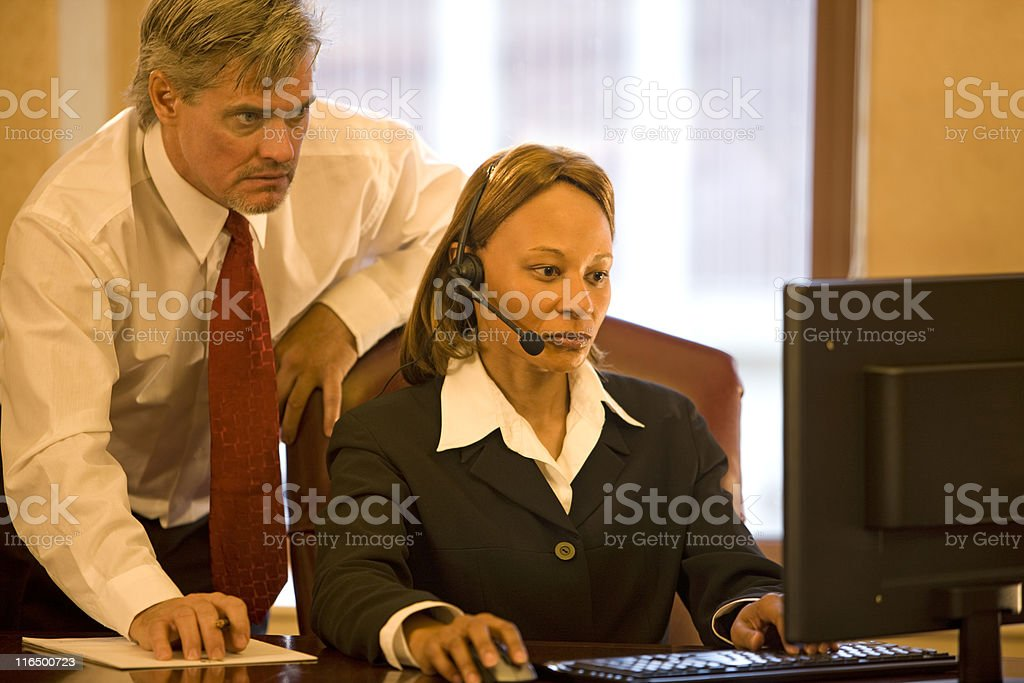 Businessman And Businesswoman Working Together royalty-free stock photo