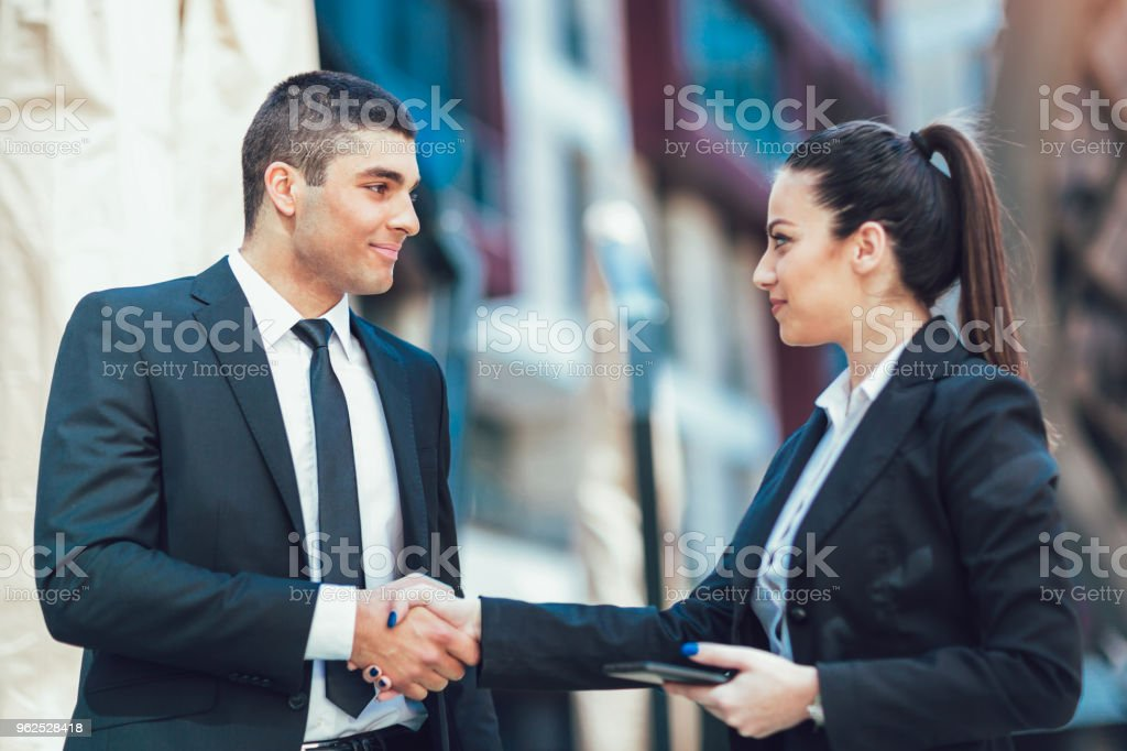 Businessman And Businesswomen Shaking Hands Outside Office - Royalty-free Adult Stock Photo