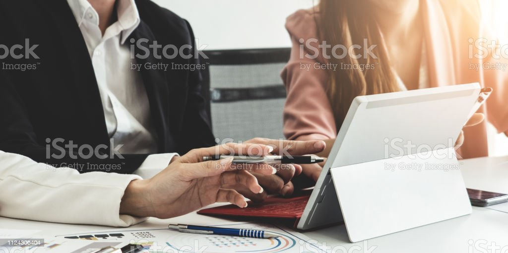 Businessman and businesswomen working in office. stock photo