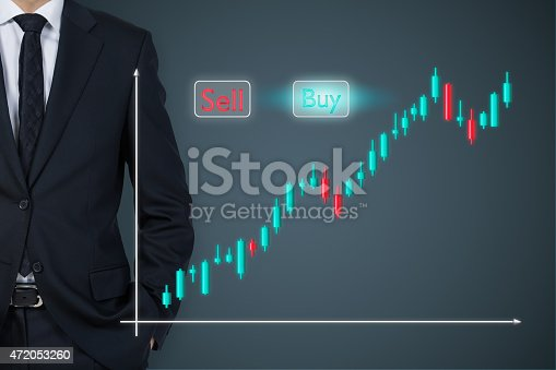 businessman standding and stock chart on virtual screen