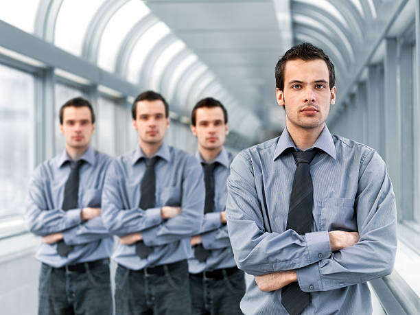 Businessman and clones stock photo