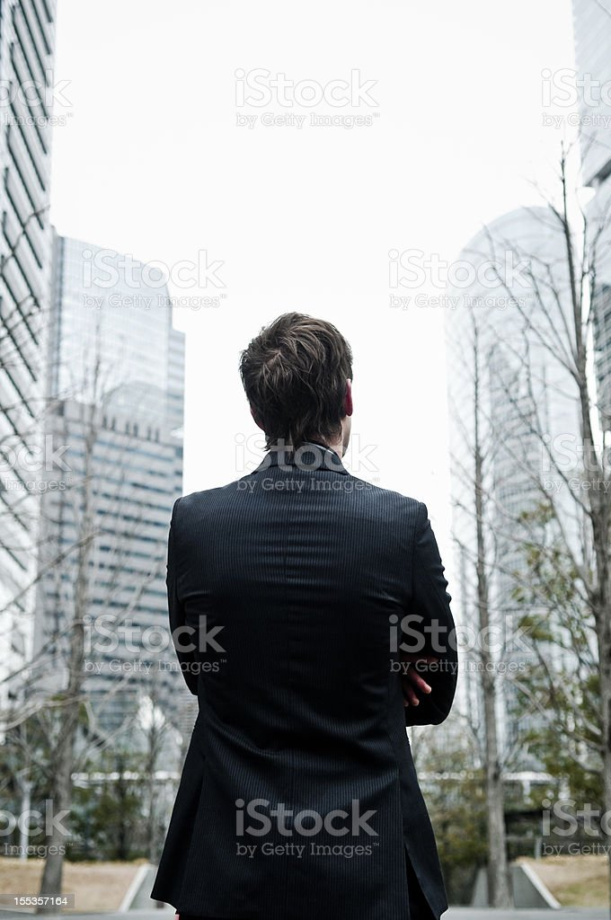 Businessman and commercial building royalty-free stock photo