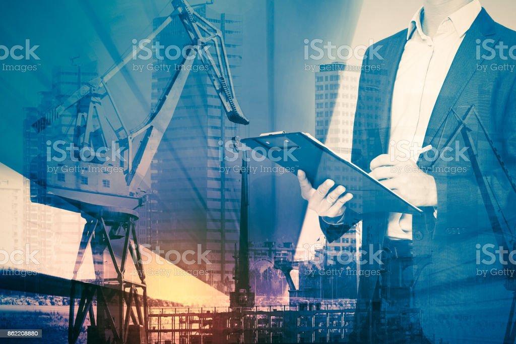 Businessman and construction crane stock photo
