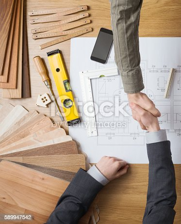 912867216istockphoto Businessman and construction engineer working together 589947542
