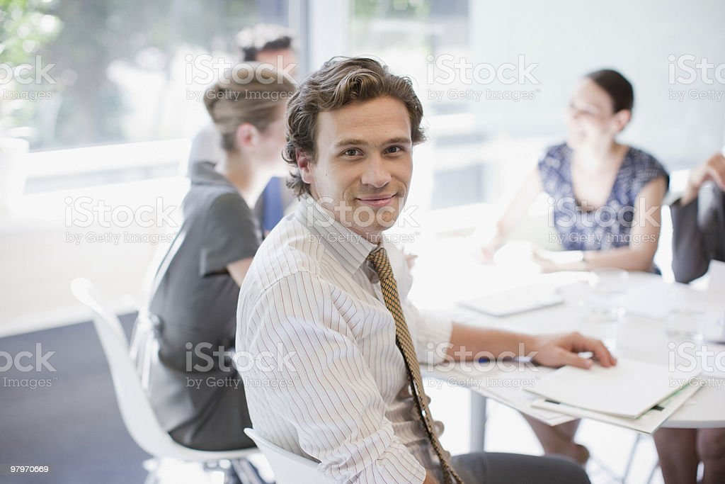 Businessman and co-workers meeting at conference table royalty-free stock photo