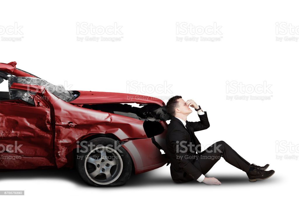 Businessman and damaged car stock photo