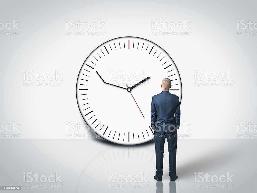 businessman and delay clock stock photo