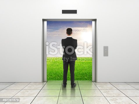 638591126 istock photo businessman and elevator 492261879