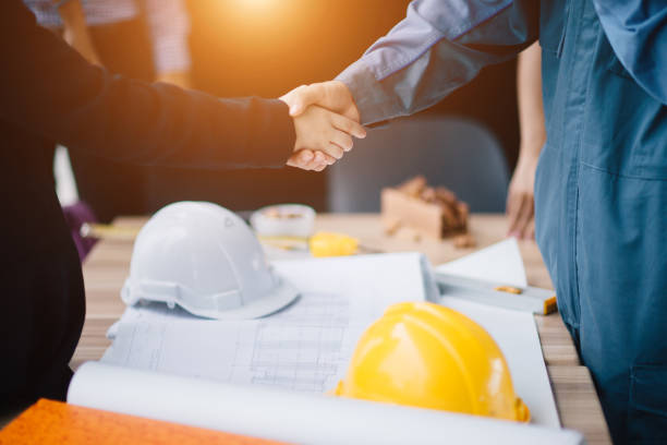 Businessman and engineer handshake closing a deal in construction site. Sucessful,engineering and business concept. stock photo
