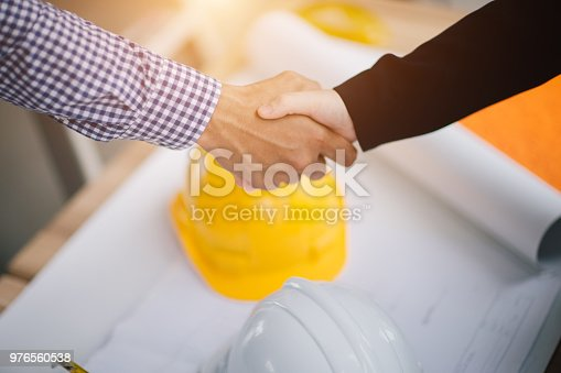 976560476 istock photo Businessman and engineer handshake closing a deal in construction site. Sucessful,engineering and business concept. 976560538