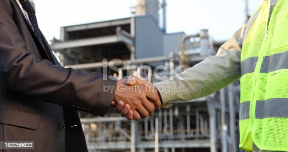 istock businessman and engineer oil refinery 162258622