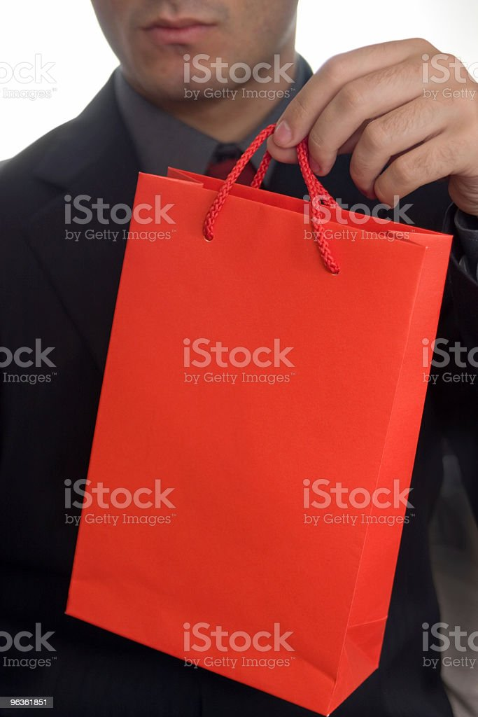 Businessman and gift bag royalty-free stock photo