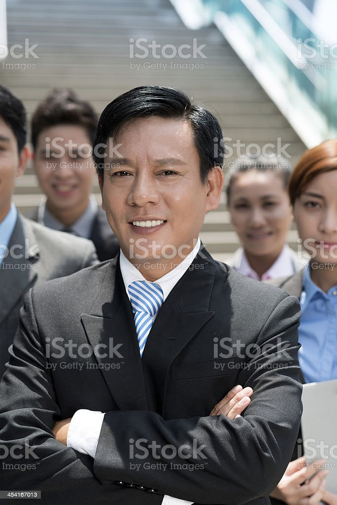 Businessman and his team royalty-free stock photo