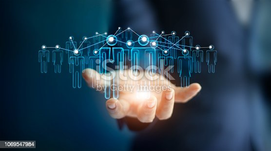 914788012 istock photo Businessman and icon business network in hand on dark background. 1069547984