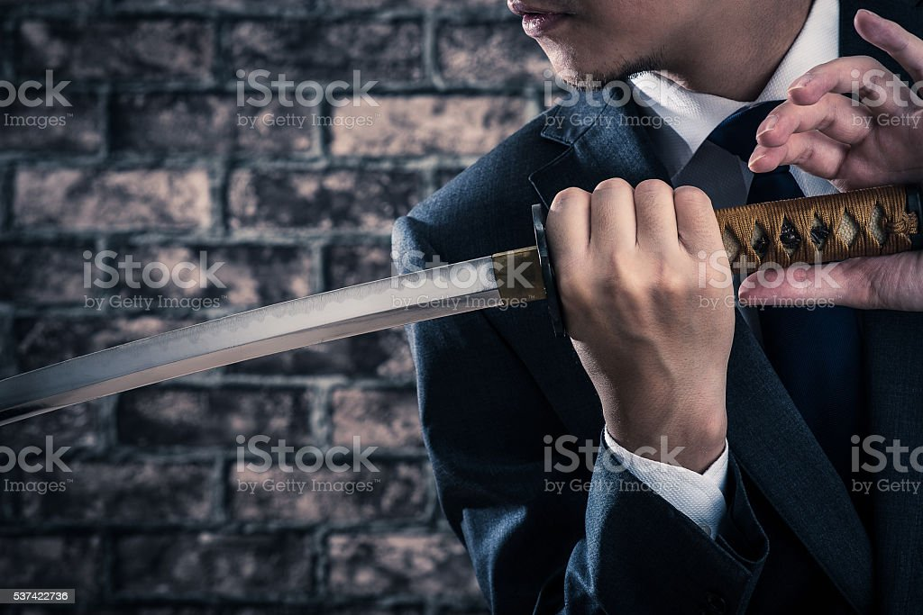 Businessman and japanese sword stock photo
