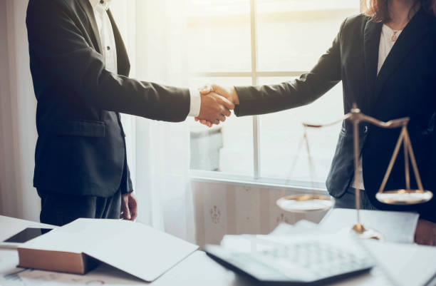 businessman and lawyer shaking hands. - lawyer stock pictures, royalty-free photos & images
