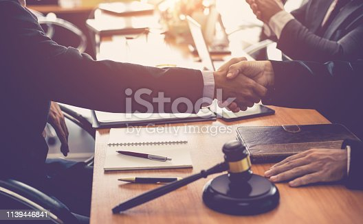 836113188 istock photo Businessman and lawyer shaking hands  to seal a deal with his partner. 1139446841