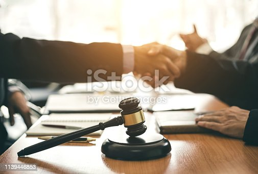 836113188 istock photo Businessman and lawyer shaking hands  to seal a deal with his partner. 1139446853