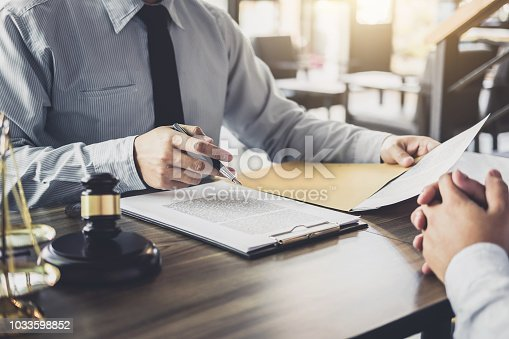 941906652 istock photo Businessman and Male lawyer or judge consult having team meeting with client, Law and Legal services concept 1033598852