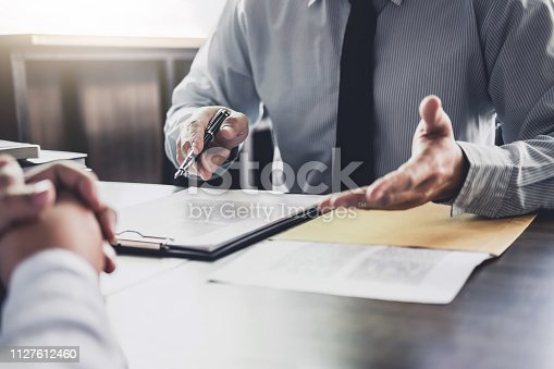 istock Businessman and Male lawyer or judge consult having team meeting with client, Law and Legal services concept 1127612460