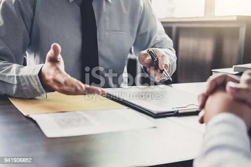 istock Businessman and Male lawyer or judge consult having team meeting with client, Law and Legal services concept 941906652