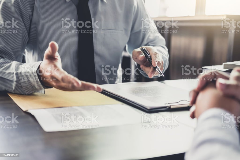 Businessman and Male lawyer or judge consult having team meeting with client, Law and Legal services concept stock photo