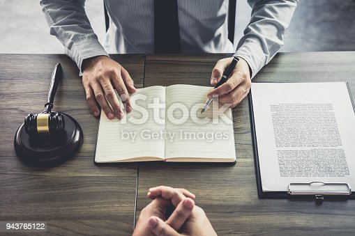 941906652 istock photo Businessman and Male lawyer or judge consult having team meeting with client, Law and Legal services concept 943765122