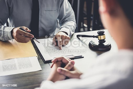 941906652 istock photo Businessman and Male lawyer or judge consult having team meeting with client, Law and Legal services concept 944211496
