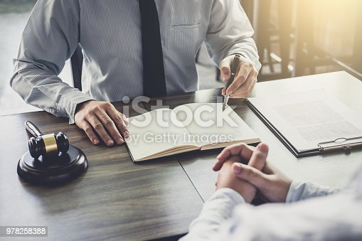 941906652 istock photo Businessman and Male lawyer or judge consult having team meeting with client, Law and Legal services concept 978258388