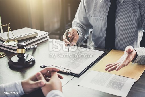 941906652 istock photo Businessman and Male lawyer or judge consult having team meeting with client, Law and Legal services concept 996232824