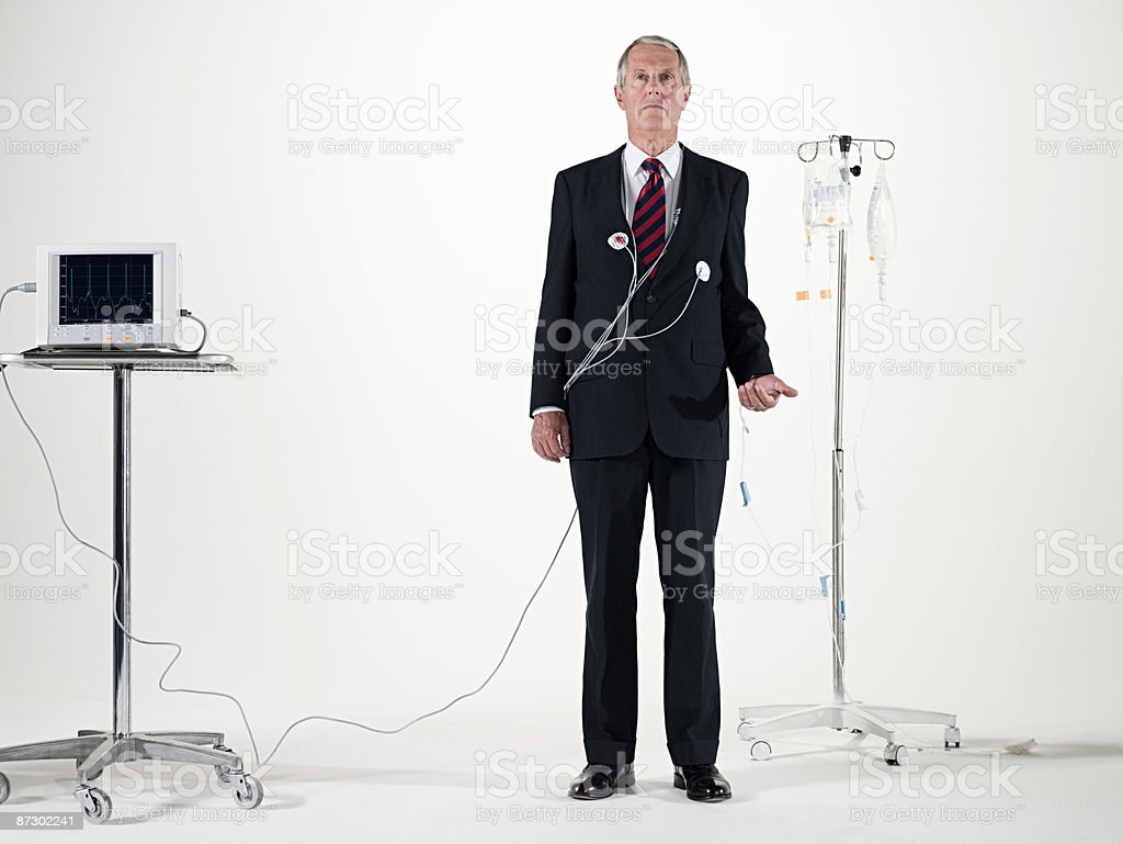 Businessman and medical equipment stock photo